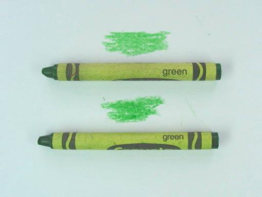 Two Green Crayons And Their Marks
